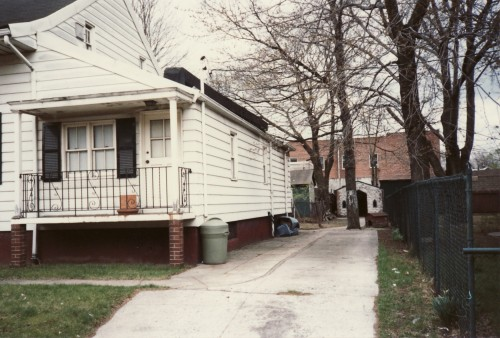 Side view of 38 Village Road North taken Wednesday 9 April 1986. Note chapel behind the tree. (Collection of Joseph Ditta)